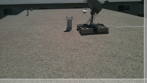 Rock roof with satellite dish installation on roof - El Segundo